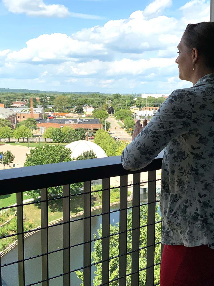 woman looking at view from a balcony
